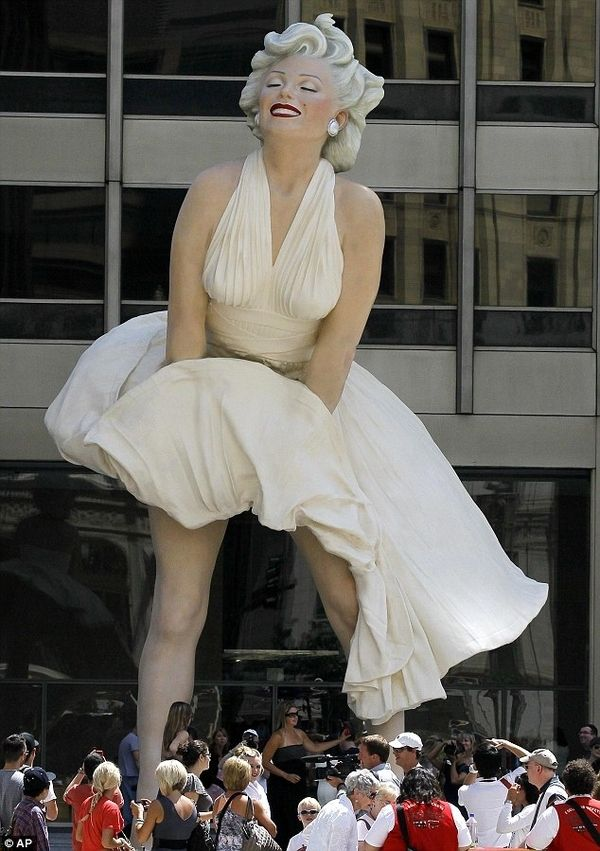 """The newest tourist attraction in Chicago is a 26-foot tall statue of Marilyn Monroe.    The sculpture was unveiled Friday morning on Michigan Avenue just north of the Chicago River. It shows Monroe during the iconic scene in """"The Seven Year Itch"""" when a gust from a subway grate blows her skirt up. Viewers can see her lacy underwear.     Artist J. Seward Johnson created the super-sized sculpture. It will be on display until next spring."""