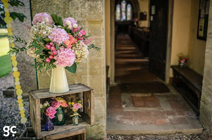 Flowers on crates outside the church at Wasing Park #weddingvenue #berkshirewedding #flowers