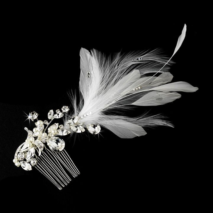 This vintage-inspired crystal and feather bridal hair comb is absolutely exquisite. It features an arrangement of luminous white faux pearls, sprays of luxurious white feathers, multiple-shaped clear