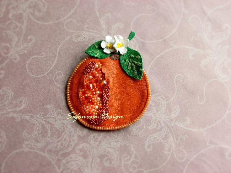 Leather brooch.