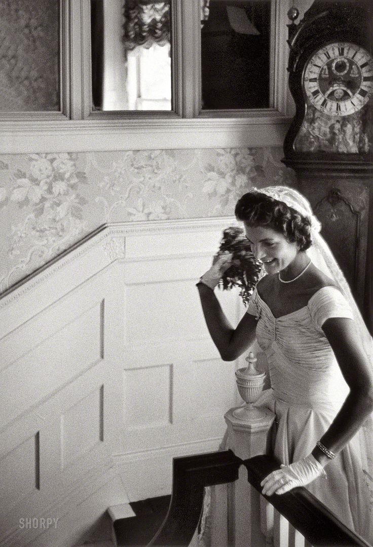 "Sept. 12, 1953. Newport, Rhode Island. ""Kennedy wedding -- Jacqueline Kennedy throwing the bouquet."" Gelatin Silver print by Toni Frissell. °"