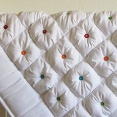 I want this quilt. I love the concept of using buttons to tie a quilt together. This one looks so snuggly- I wish there was a tutorial!
