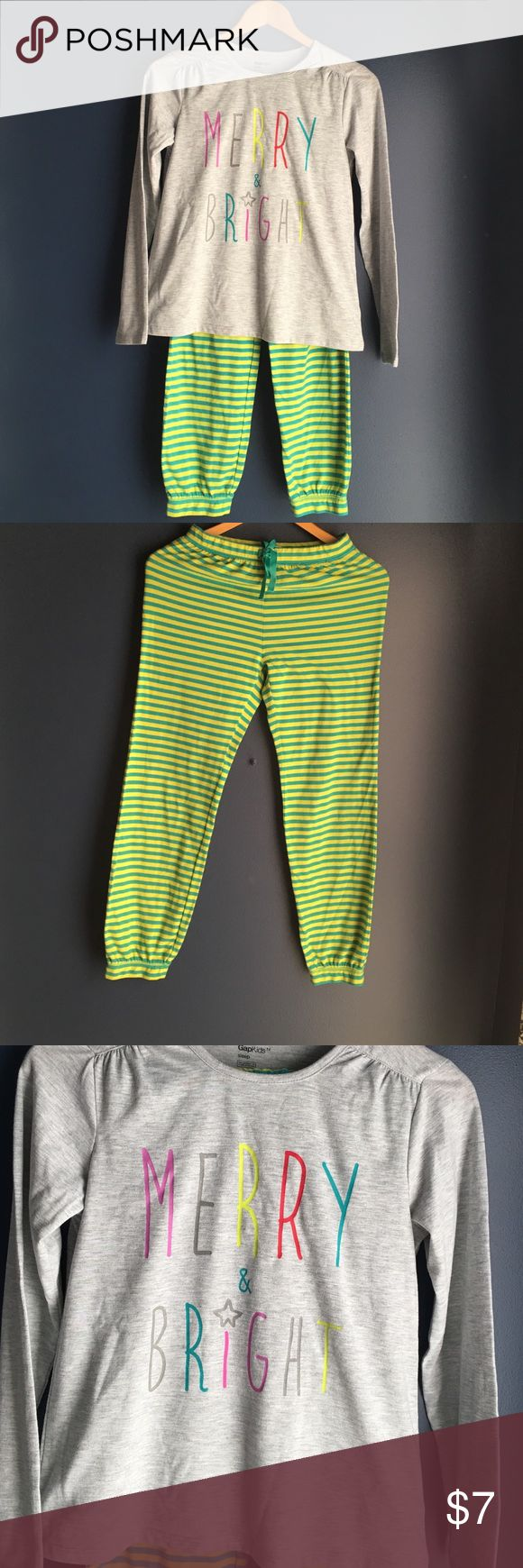 """GapKids Pajama Set So cute and comfy, these gap pajamas for kids are so fun. Striped pants and a gray T-shirt with """"Merry and Bright"""" in colorful letters. Shirt is size 14 pants are size 12. GapKids Pajamas Pajama Sets"""