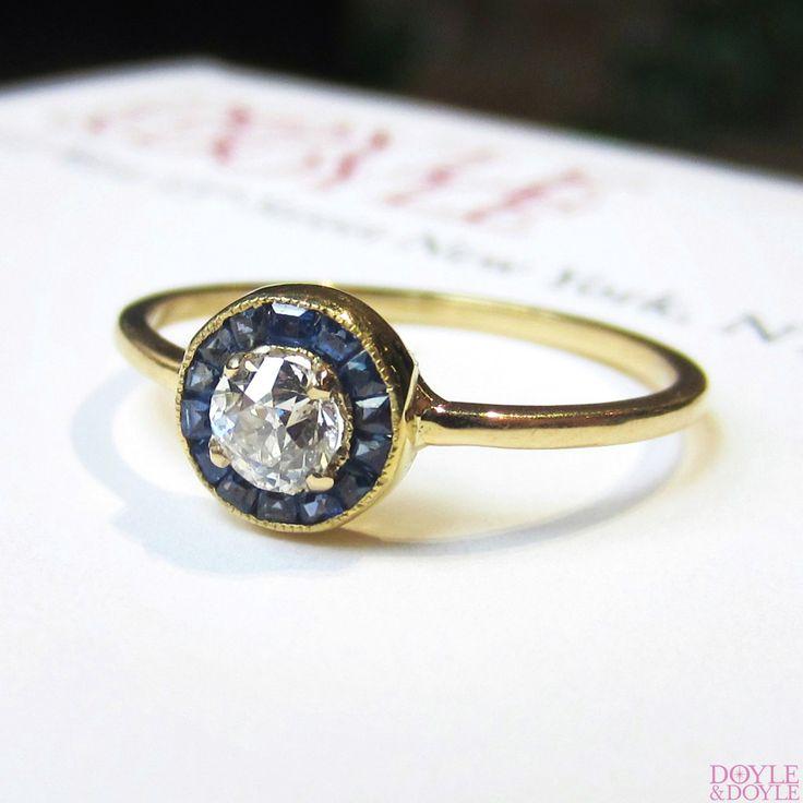 Sweet Edwardian diamond and sapphire halo engagement ring, from Doyle & Doyle.