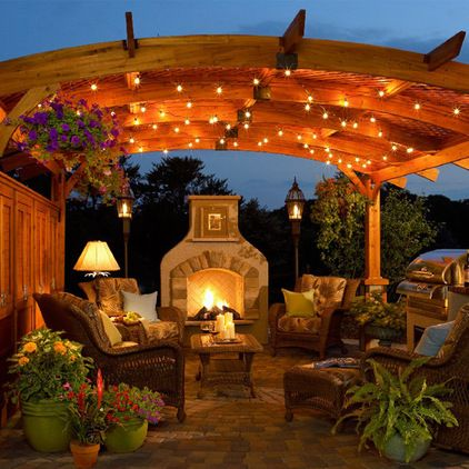 Add some punch to your pergola with a sheltering arch, then string it with lights for a veil of dappled illumination.