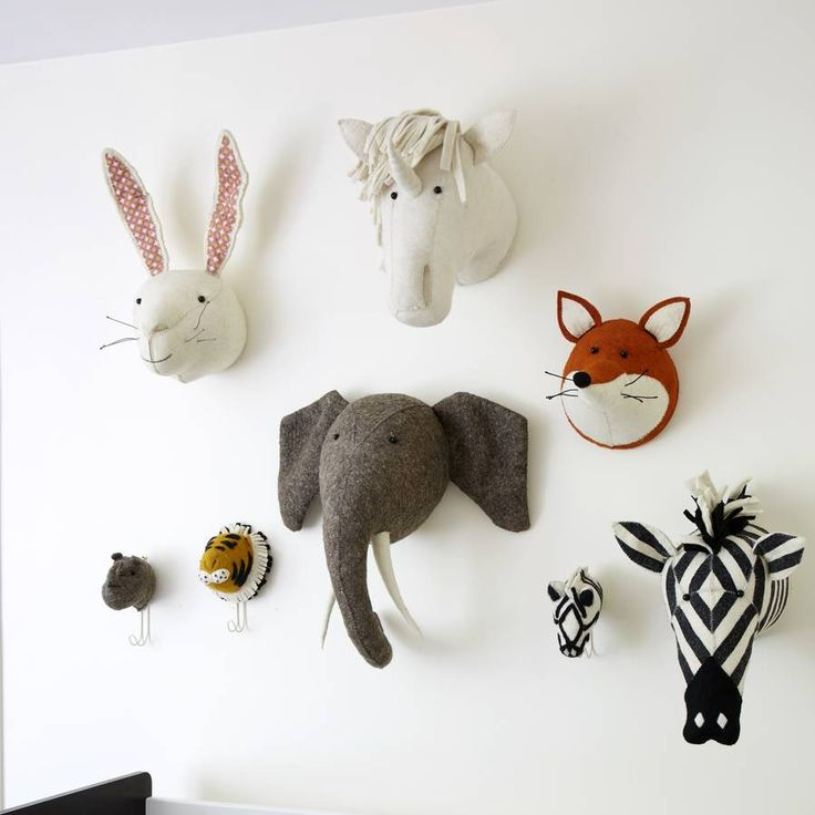 Animal decorative felt head in a choice of styles.Elephant Giraffe Rhino Tiger White RabbitTurn your child's bedroom into a wildlife safari or woodland playground with these amazing felt animal heads. They are available in nine designs , elephant , giraffe , rhino , tiger , zebra , fox , scottie dog , fox terrier dog and cream rabbit with pink printed ears You might need more than one ! The heads are beautifully designed and ethically made from hardwearing wool felt with stitching detail…