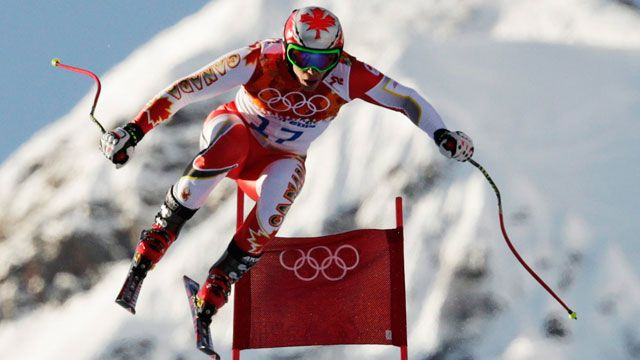 Day Two: Canada's Erik Guay makes a jump during a men's downhill training run for the Sochi 2014 Winter Olympics, Friday, Feb. 7, 2014, in Krasnaya Polyana, Russia. (AP Photo/Charles Krupa) Sportsnet.ca