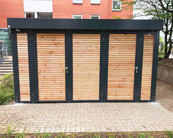 Einhausung mit Holz Garagentore, Garage und hobbyraum