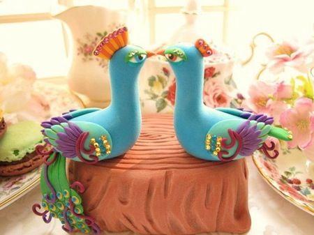 peacocks as a cake topper.