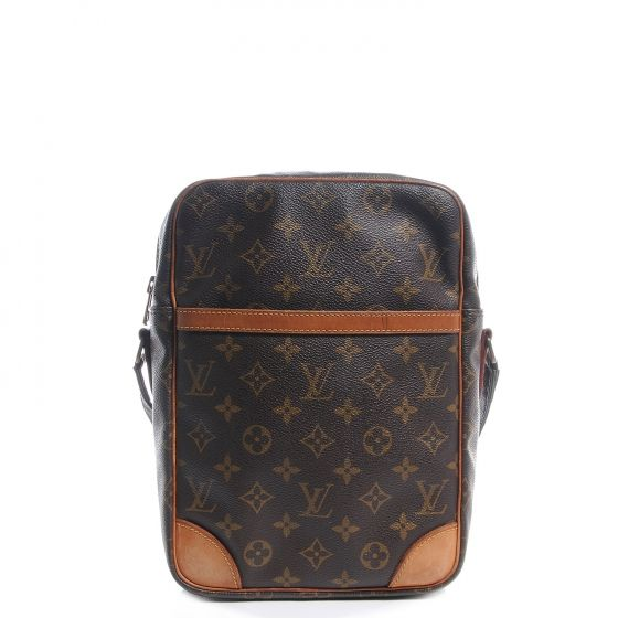 This is an authentic LOUIS VUITTON Monogram Danube 28.   This is a compact and distinctive messenger style shoulder bag that is crafted of traditional Louis Vuitton monogram on coated canvas.