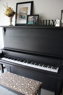 Black piano. Distress mine, add fleur de lis or burlap and candle holders