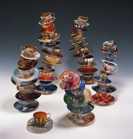 these topsy turvy teacups are made from recycled tin cans!