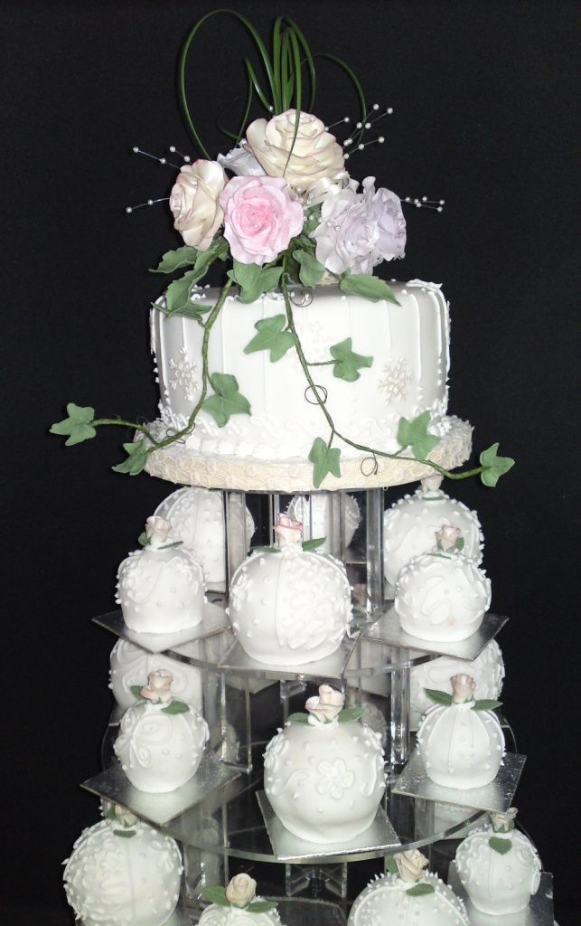 Tower Of Cake Baubles With Rosebud Sugar Flowers To Each The Top For