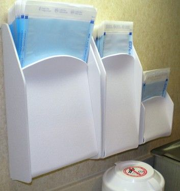 Dispensers for sterilization pouches and digital sensor sleeves