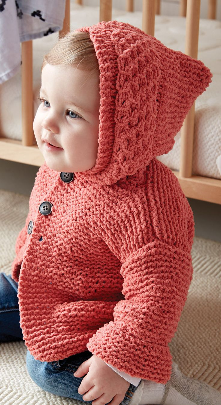 Free Knitting Pattern for In the Details Baby Hoodie - Hooded baby cardigan sweater knit in garter stitch with smoked stitch around the hood. Sizes 6, 12, 18, and 24 mths. Designed by Bernat Design Studio