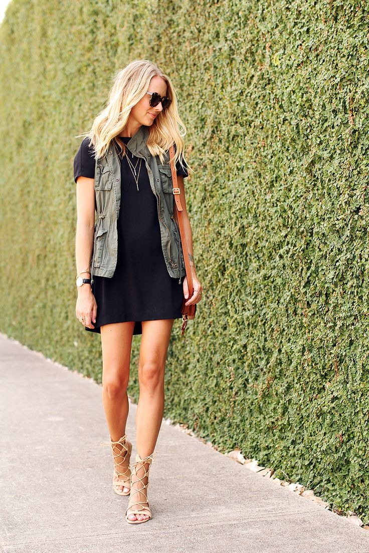 black dress, olive vest, nude sandals, gold necklace