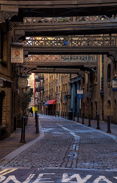 Multiple foot bridges connect the buildings at Butlers Wharf in London. Butler's Wharf is an English historic building on the south bank of the River Thames, just east of London's Tower Bridge, now housing luxury flats and restaurants. Lying between the picturesque street Shad Thames and the Thames Path, it overlooks both the bridge and St Katharine Docks on the other side of the river. See more of London here or connect on Facebook Jon & Tina Reid