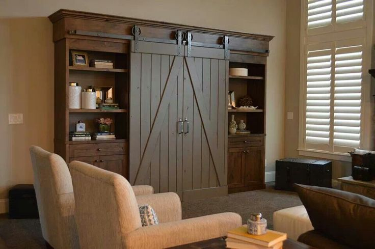 I love the idea for the barn door to cover up the entertainment center. I would have the entertainment center recessed into the wall though.