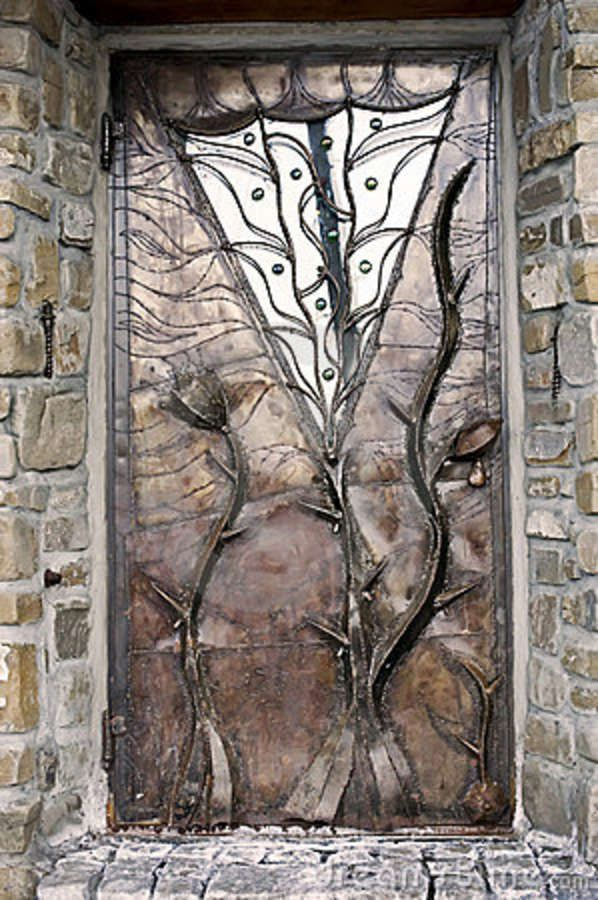 Metal Door; reminds me of crinoid (sea lily) fossils.