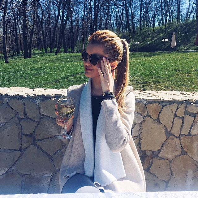 @cristinagheiceanu in the sun, wearing our Q bracelet