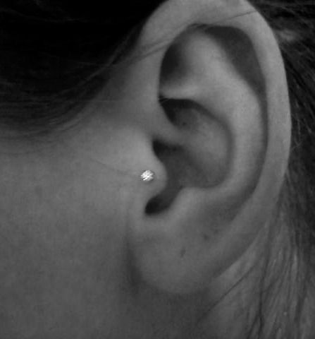 As much as I love my tragus piercing, due to future plans and athletics I am thinking about taking it out.