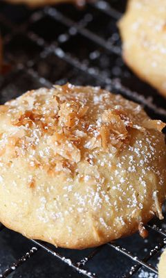 Pineapple Cookies - These cakey cookies are light and tender. The pineapple and coconut blend for a subtle, sweet flavor with a tropical twist, a delicious sweet treat for summer. The perfect recipe for a party or picnic, these would also be fun to bake for a holiday cookie exchange. Serve these as an after school snack, a lunch box treat or after-dinner dessert well into the fall months.