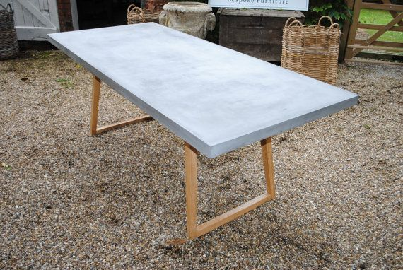 We are delighted to present our Concrete dining table supported by Oak legs. 200cm long x 92cm wide x 76cm high. Delivery to England and Wales is