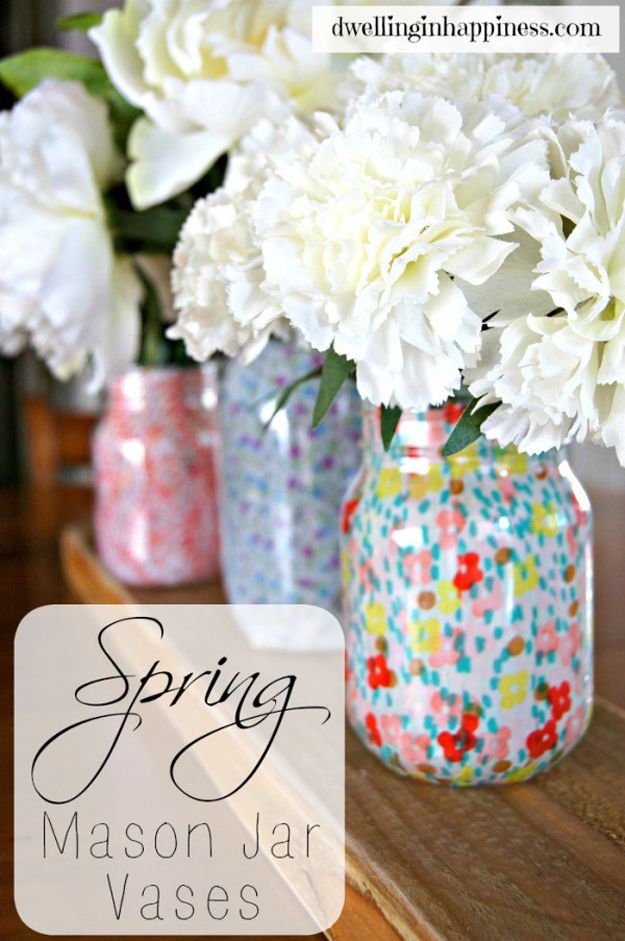 via Dwelling in Happiness  A perfect living room decor or gift idea. Make these adorable mason jar vases with some mod podge and fabric. The project only takes a few minutes but you may need a few hours to let everything dry. Get the tutorial here.