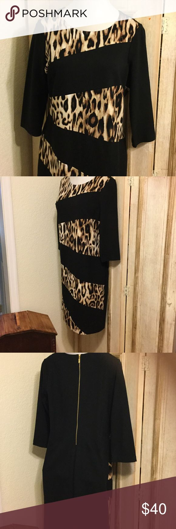 Fabulous Chicos dress! Size 2.5 Splice Animal print on front solid black on back. Exposed gold back zipper and lined. Waist 18 40 inches long from the shoulder bust 22inches lying flat. Figure flattering. No low ball offers please. Chico's Dresses