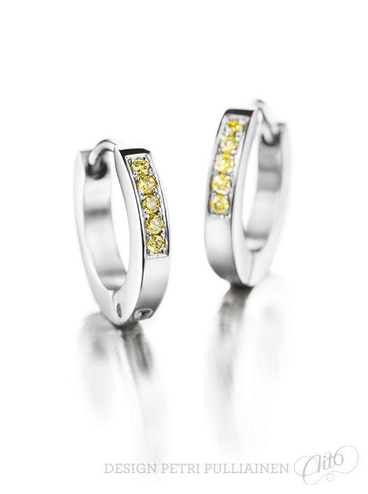Stainless steel ear rings with canary-yellow diamonds. Photo Mikael Pettersson.