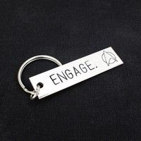 "This ""Engage"" aluminum key chain is hand stamped with care, one letter at a time. At the end of the"