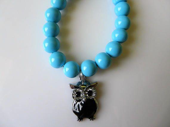 Cute handmade blue bracelet with a black owl
