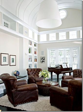 Barrel vault ceiling- chesterfield chairs - double row of windows