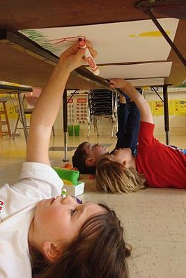 Have students lay under their tables or desks and reach up to color or draw on paper taped on the bottom of their table/desk...great way to sneak in shoulder and wrist strengthening!