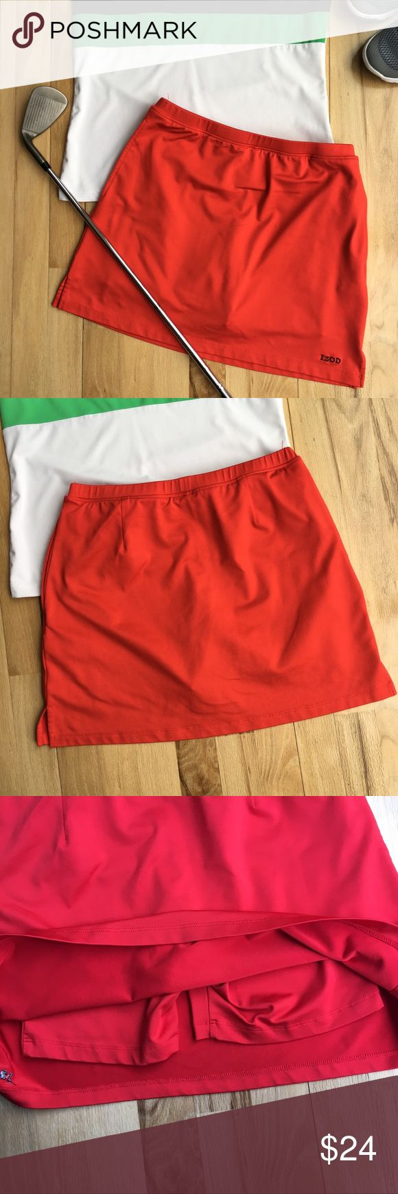 IZOD Cool FX Red Golf Athletic Skirt IZOD Cool FX Red Athletic Skirt with Pockets and built in under shorts. Super cute for the tennis court or golf course this spring! Excellent condition. 90% polyester 10% Spandex. Machine wash/dry. Measures 13in across at waist, 14in length. Izod Skirts