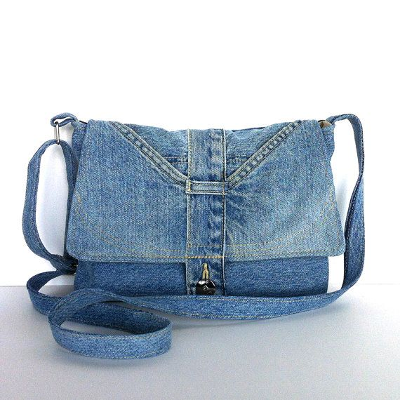 This is a unique small messenger or shoulder bag that I made out of a light blue jean pant.  The bag has a beautiful flap with two original pockets.I