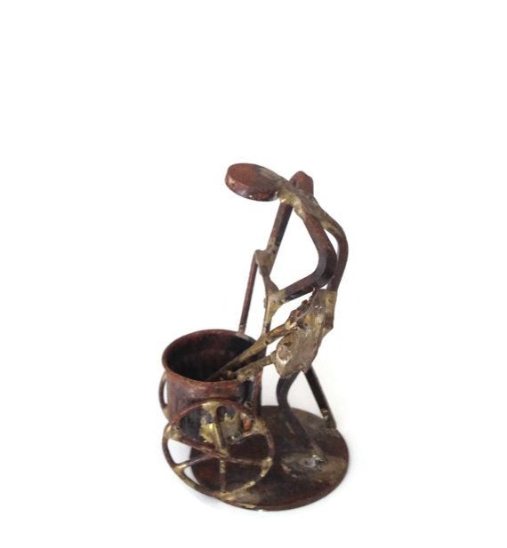 Heavy patina on this brass stick man figurine adds to his #vintage charm.  This 1950's Mid-Century modern figurine is a very tired looking man hunched over his wheel barrow ... #etsy #vougeteam
