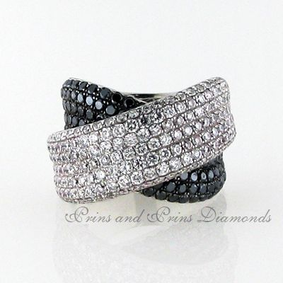 There are 88 = 1.24ct round black diamonds and 185 = 2.25ct GH/VS – SI round brilliant cut diamonds pavé set in a chunky 18k white gold crossover ring