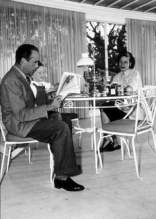 Humphrey Bogart, Lauren Bacall, and their son, Stephen, at home in Los Angeles, CA, 1952.
