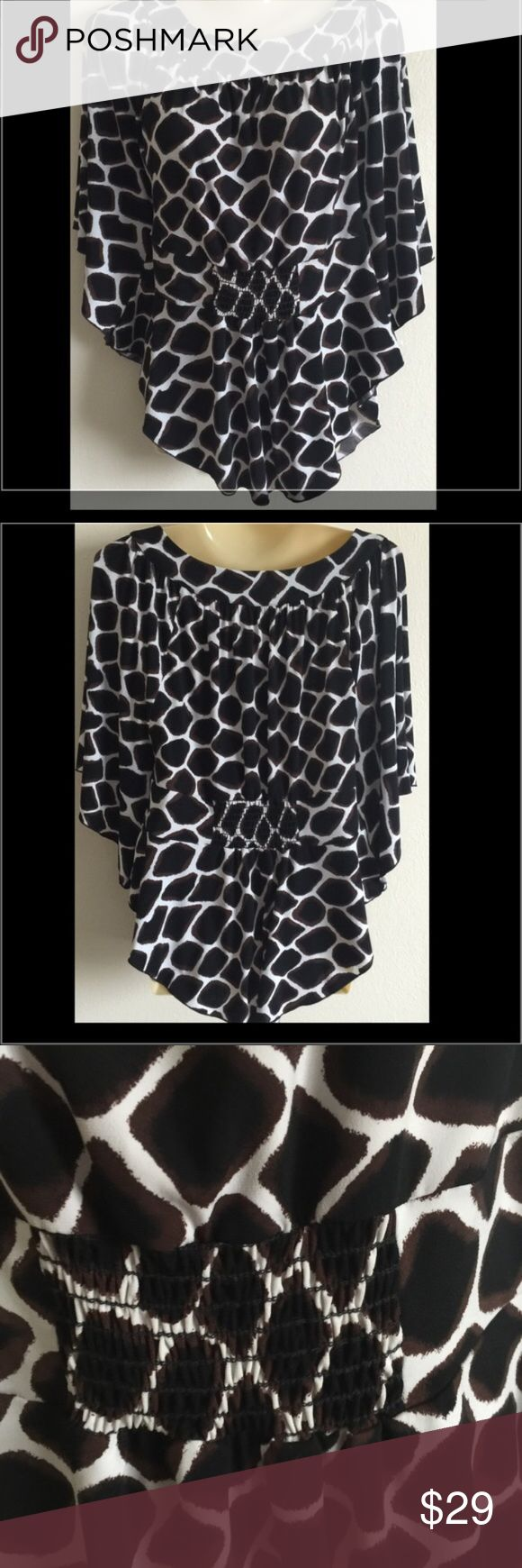 NEW White House Black Market Batwing Giraffe Top White House Black Market Batwing Dolman Giraffe Animal Print Top Shirt XS Condition: ExcellentColor: black, brown and white  Fabric: polyester spandex Hand wash     /344/ White House Black Market Tops