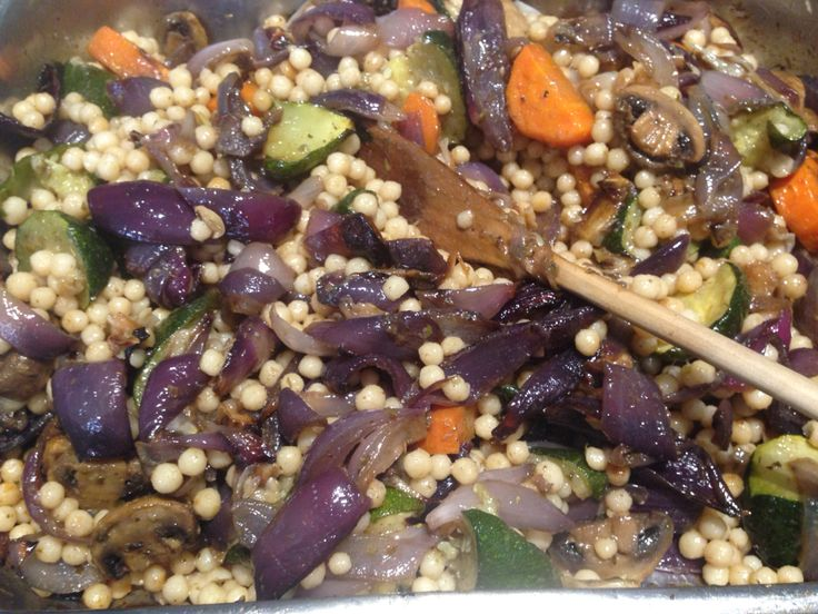 Pearl couscous with roasted Spanish onions, carrots, zucchini, mushrooms, garlic and cumin - top it off with sultanas and walnuts for added sweet crunch! #madebyjo