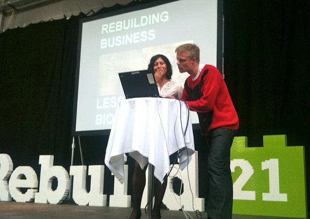 Torben Olander provides Rebuild21 Speaker, Nadine Gudz with tech support.