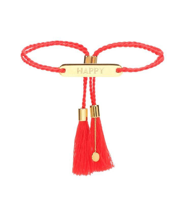 """Chloé - Bracelet à houppes - Ultra-simple, ce bracelet à plaque dorée façon gourmette gravée de la mention """"Happy"""" est signé Chloé. Les liens torsadés en coton rouge son ajustables et ornés de houppes. seen @ www.mytheresa.com"""