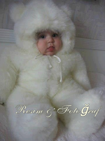 Fat baby in a fluffy furry white bear suit.