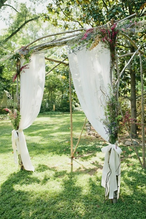 Wow, we could easily just make this out downed tree limbs from the backyard and woods, some rope and 4 sheer curtains.  Hmmmmmm....this could work.