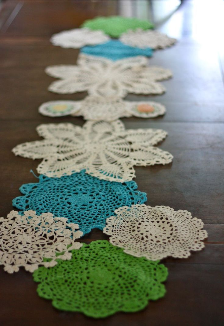 Doily table runner - This might be a great way to use the doilies that have stains - just dye first.