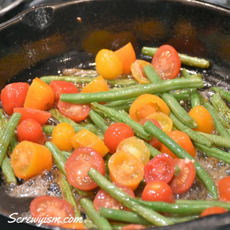 Green Beans and Tomato Garlic Butter Saute. A simple green bean recipe that s a flavorful combination of fresh green beans, grape tomatoes and garlic butter,