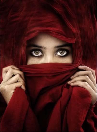 I love her eyes and the saturation of the red fabric.