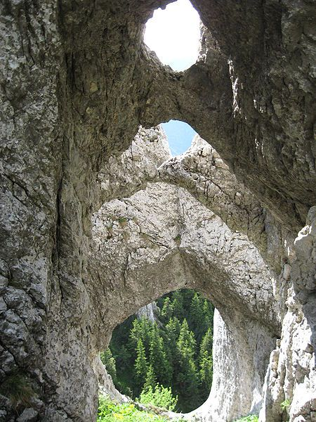 Natural stone canopy - La Zaplaz in Piatra Craiului mountains, Romania. Want more amazing places? Stay tuned to our boards!