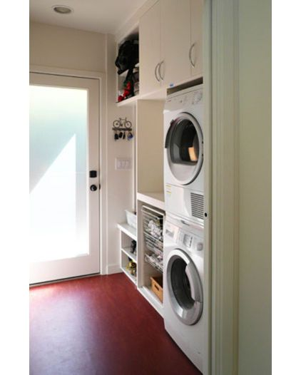 Modern laundry room by Klopf Architecture - Nice for small laundry room area.